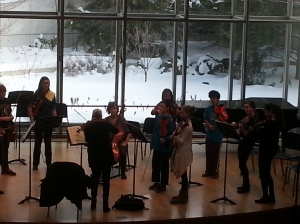 Annie Fullard leading young chamber orchestra students